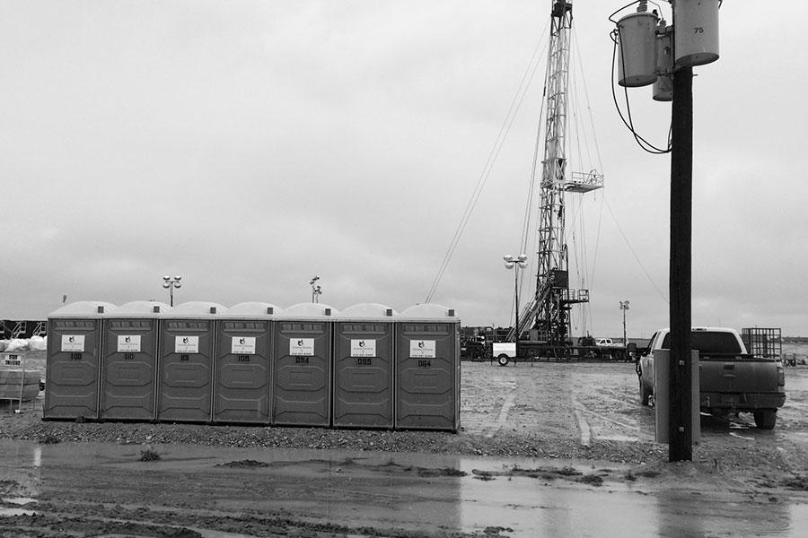Portable toilets on job site- Versatile Industries V, LLC| Midland & Trenton TX